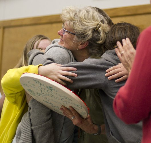 Nancy O'Connor, coordinator of the West Junior High School garden project, is hugged by student gardeners during a recognition ceremony Saturday, Nov. 6, 2010, in the cafeteria.