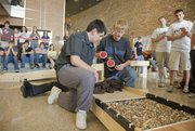 "De Soto high school students Raul Deleon and Mark Trasher prepare their team&squot;s multi-terrain vehicle during the semi-final round of the KU School of Engineering&squot;s ""Claim the Terrain"" competition Tuesday, Nov. 9, 2010."