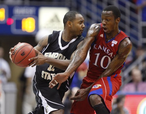 Kansas guard Tyshawn Taylor tries to strip the ball from Emporia State guard Robert Moores during the first half, Tuesday, Nov. 9, 2010 at Allen Fieldhouse.
