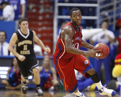 Kansas guard Tyshawn Taylor turns up the court after picking up a loose ball against Emporia State during the first half, Tuesday, Nov. 9, 2010 at Allen Fieldhouse.