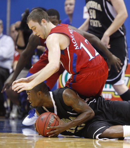 Kansas guard Brady Morningstar looks to wrestle for the ball with Emporia State guard Xavier Burnett during the first half, Tuesday, Nov. 9, 2010 at Allen Fieldhouse.