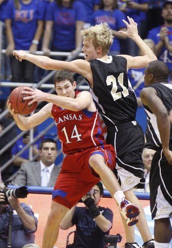 Kansas guard Tyrel Reed grabs a rebound from Emporia State forward Matt Boswell during the first half, Tuesday, Nov. 9, 2010 at Allen Fieldhouse.