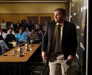 Dan Hawkins leaves a news conference Tuesday at the University of Colorado in Boulder, Colo., during which athletic director Mike Bohn announced that Hawkins had been relieved of his duties as head football  coach.