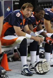 Denver Broncos quarterback Kyle Orton (8) and Eddie Royal watch the final minutes of the team's 59-14 loss to the Oakland Raiders on Oct. 24 in Denver. The Broncos play the Chiefs this weekend.