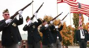 The Honor Guard fires during Veterans Day events at the American Legion Post, 3408 W. Sixth Street, on Thursday, Nov. 11, 2010.