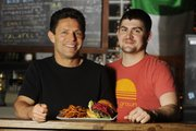Robert Krause, left, and business partner Simon Bates own both The Burger Stand at The Casbah, 803 Mass. and its neighboring restaurant Esquina. They are preparing to open their second Burger Stand location in Topeka.