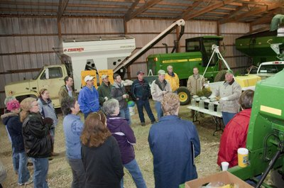 As a heavy rain falls outside, Douglas County farmer Mark Wulfkuhle, second from right, talks about some of his farming practices at his Rocking H Ranch during the Douglas County Food Policy Council tour of Douglas County farms Friday, Nov. 9, 2010. According to a new report released by the council, there are 1,040 farms in Douglas County, down 36 percent from 1,630 in 1950.