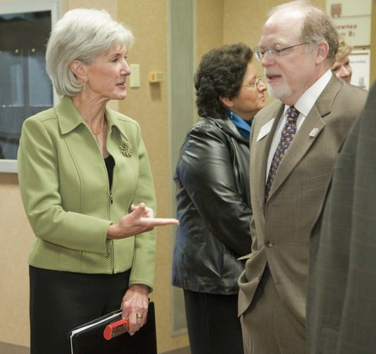 U.S. Department of Health and Human Services Secretary Kathleen Sebelius visits with Thomas Bell, president of the Kansas Hospital Association, Friday, Nov. 9, 2010. Sebelius spoke at the KHA's 2010 Annual Convention and Trade Show in Topeka.