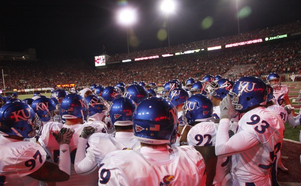 Kansas players gather after warm ups before kicking off against Nebraska, Saturday, Nov. 13, 2010 at Memorial Stadium in Lincoln.