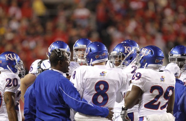 Kansas head coach Turner Gill gathers his offense during a timeout against Nebraska during the third quarter, Saturday, Nov. 13, 2010 at Memorial Stadium in Lincoln.