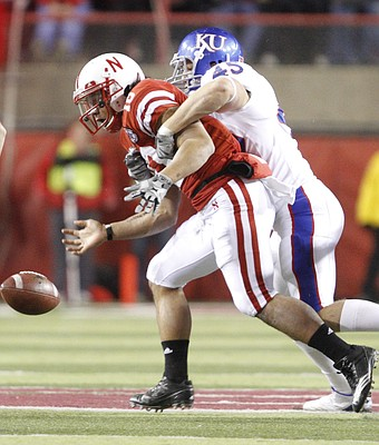 Kansas linebacker Justin Springer causes Nebraska running back Roy Helu Jr. to fumble during the third quarter, Saturday, Nov. 13, 2010 at Memorial Stadium in Lincoln.