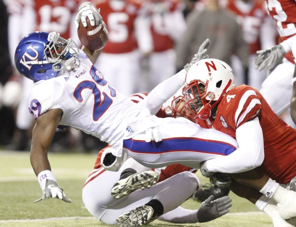 Nebraska linebacker Lavonte David stops Kansas running back James Sims during the third quarter, Saturday, Nov. 13, 2010 at Memorial Stadium in Lincoln.