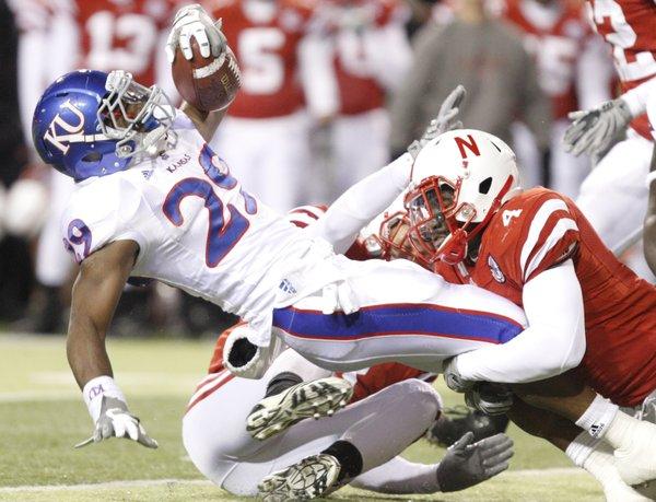 Nebraska linebacker Lavonte David stops Kansas running back James Sims during the third quarter, Saturday, Nov. 13, 2010 at Memorial Stadium in Lincoln.
