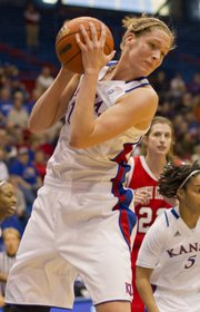 Kansas University center Krysten Boogaard pulls down a rebound during the Jayhawks' season opening game against South Dakota Sunday afternoon in Allen Fieldhouse. Kansas won the game 73-40.