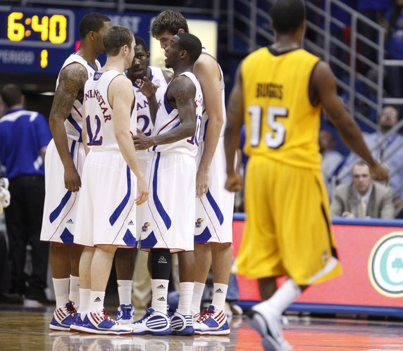 The Jayhawks talk strategy during a timeout against Valparaiso during the first half, Monday, Nov. 15, 2010 at Allen Fieldhouse.