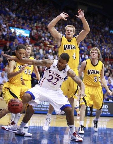 Kansas forward Marcus Morris gets physical as he clears out Valparaiso guard Jay Harris, left, while going for a loose ball during the first half, Monday, Nov. 15, 2010 at Allen Fieldhouse. Also pictured are Valpo defenders Kevin Van Wijk (55), Cory Johnson (4) and Ryan Broekhoff (45).