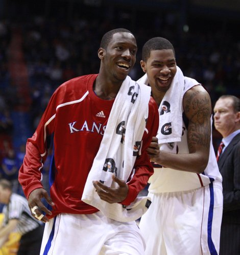Kansas players Tyshawn Taylor, front, and Marcus Morris have a laugh in the closing minutes of Monday's 79-44 win over Valparaiso at Allen Fieldhouse.