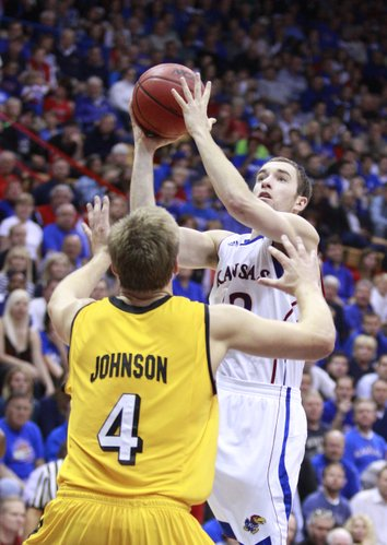 Kansas guard Brady Morningstar elevates to the bucket over Valparaiso forward Cory Johnson during the second half, Monday, Nov. 15, 2010 at Allen Fieldhouse.