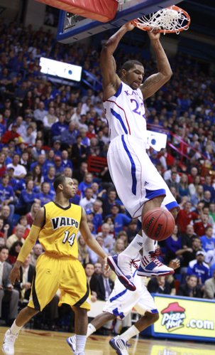 Kansas forward Marcus Morris comes down form a dunk against Valparaiso during the first half, Monday, Nov. 15, 2010 at Allen Fieldhouse. At right is Valpo guard Howard Little.