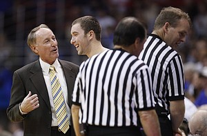 Kansas guard Brady Morningstar has a laugh with Valparaiso head coach Homer Drew as officials reset the game clock during the second half, Monday, Nov. 15, 2010 at Allen Fieldhouse.