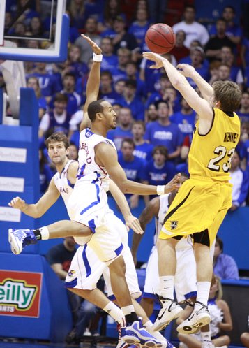 Kansas guard Travis Releford jumps in to defend against a shot by Valparaiso guard Matt Kenney during the second half, Monday, Nov. 15, 2010 at Allen Fieldhouse. Also pictured is Kansas center Jeff Withey.