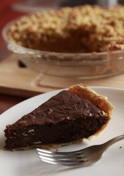 "Chocolate pecan pie, front, and ""Knock Your Socks Off"" pumpkin pie."