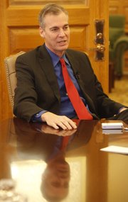 Outgoing Democratic Gov. Mark Parkinson talks Tuesday in Topeka about his accomplishments in office and what he expects to happen with the incoming Republican administration of Gov.-elect Sam Brownback.