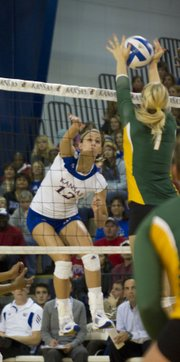 Baylor's Torri Campbell (7) blocks Kansas' Jenna Kaiser's (12) spike during the Jayhawks' loss on Wednesday at Horejsi Center.