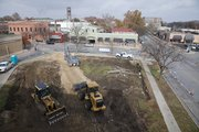 Construction crews on Thursday were starting ground work on a new apartment and retail complex going up on the southwest corner of Ninth and New Hampshire streets.