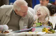 George Moeller, Mission Hills, gets a laugh out of granddaughter Edie Patterson, a kindergartner at Pinckney School, during Grandparents and Special Friends Day on Thursday at the school.
