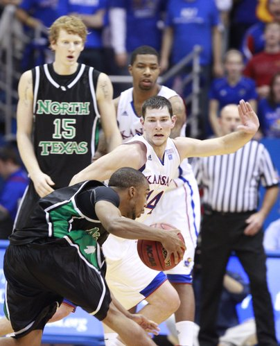 Kansas guard Tyrel Reed moves his feet as he defends North Texas guard Dominique Johnson during the first half Friday, Nov 19, 2010 at Allen Fieldhouse.