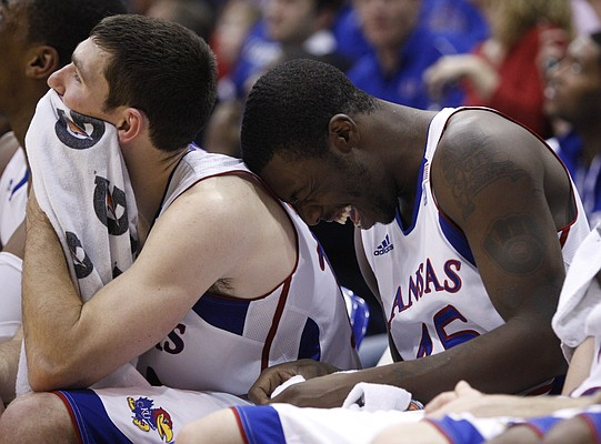 Kansas guard Elijah Johnson, right, laughs against teammate Tyrel Reed after viewing a photo slideshow of Reed as a child on the big screen during the second half Friday, Nov 19, 2010 at Allen Fieldhouse.