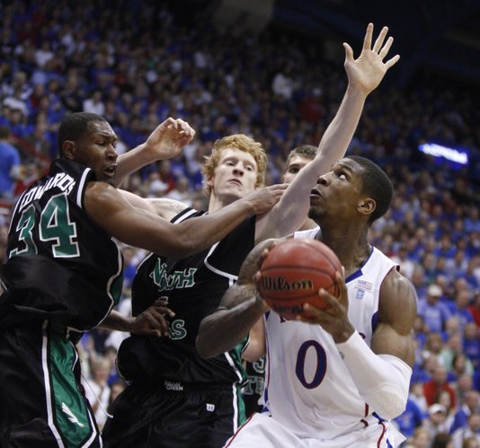 Kansas forward Thomas Robinson eyes the bucket as he moves in against North Texas defenders Alonzo Edwards (34) and Ben Knox (15) during the second half Friday, Nov 19, 2010 at Allen Fieldhouse.