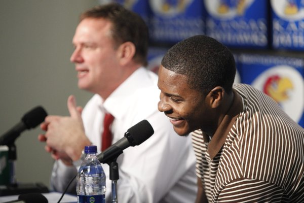 Kansas freshman guard Josh Selby laughs with head coach Bill Self during a news conference announcing that Selby will be released to play following a nine-game suspension. Selby's first game will be Saturday against USC.