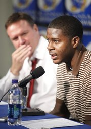 Kansas freshman guard Josh Selby talks with media members along side head coach Bill Self during a news conference announcing that Selby will be released to play following a nine-game suspension.