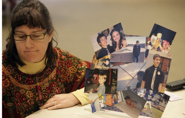 Karen Smart, Lawrence, talks about her late son Jacob Wessel after attending a National Survivors of Suicide Day event Saturday, Nov. 20, 2010, in downtown Lawrence. Her son died by suicide on April 19, 2010, at age 15. She made a mini-collage of Jacob's pictures, at left.