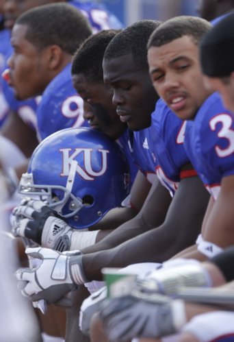 Pictured from left, Kansas defensive players, Richard Johnson, Steven Johnson, Olaitan Oguntodu and Tyler Patmon sit together on the bench late in the fourth quarter of the Jayhawks' 48-14 loss to Oklahoma State, Saturday, Nov. 20, 2010 at Kivisto Field.