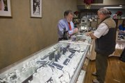 Ernie Cummings, left, helps customer David Lahm, of Lawrence, Tuesday at Kizer Cummings Jewelers, 833 Mass. Cummings said that diamond earrings, pendants and rings are selling well at the store this year along with the more inexpensive designer lines of silver jewelry.