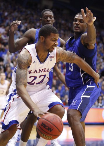 Kansas forward Marcus Morris fights his way out of a trap by Texas A&M-Corpus Christi defenders Justin Reynolds, right, and Horace Bond during the first half, Tuesday, Nov. 23, 2010 at Allen Fieldhouse.