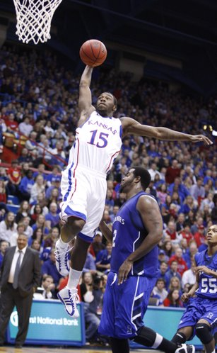 Kansas guard Elijah Johnson gets up for a tomahawk jam over Texas A&M-Corpus Christi forward Jawan Nelson during the first half, Tuesday, Nov. 23, 2010 at Allen Fieldhouse.