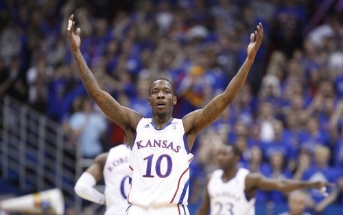 Kansas guard Tyshawn Taylor brings the Fieldhouse to its feet after a dunk by teammate Travis Releford against Texas A&M-Corpus Christi during the first half, Tuesday, Nov. 23, 2010.