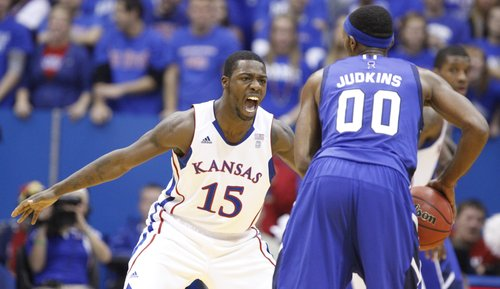 Kansas guard Elijah Johnson gets down on defense as he watches Texas A&M-Corpus Christi guard Garland Judkins during the first half, Tuesday, Nov. 23, 2010 at Allen Fieldhouse.