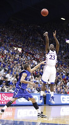 Kansas forward Mario Little puts up a three-pointer over Texas A&M-Corpus Christi forward Chris Mast during the second half, Tuesday, Nov. 23, 2010 at Allen Fieldhouse.