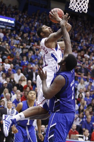 Kansas forward Markieff Morris battles for a bucket over Texas A&M-Corpus Christi forward Jawan Nelson during the first half, Tuesday, Nov. 23, 2010 at Allen Fieldhouse.