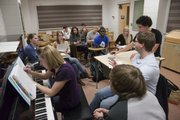 The Kansas University glee club, Genuine Imitation, rehearses in Murphy Hall for upcoming performances. Pianist Sara Blakesley, left, is the club's director.