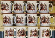 Mugs commemorating the forthcoming marriage of Britain's Prince William to Kate Middleton are stacked Tuesday at the Prince William Pottery Company in Liverpool, England Prince William and Kate Middleton will marry April 29 in Westminster Abbey, the historic London church where Princess Diana's funeral took place.