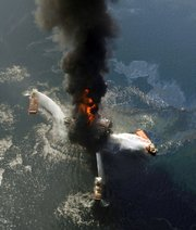 The Deepwater Horizon oil rig burns after an explosion in the Gulf of Mexico in this April 21 photo. A new study from the presidential oil spill commission describes the behind-the-scenes, excruciating tension and mistakes behind the effort to cap the well.