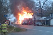 Flames burn a home on U.S. Highway 40 near the Shawnee County line on Wednesday, Nov. 24, 2010.