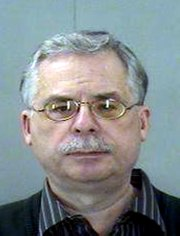 This Nov. 18, 2010 photo provided by the Dallas County Sheriff's Department shows John Fiala. Fiala, a former Roman Catholic priest charged with sexually abusing a teenage boy in 2008 in his rural Texas parish is now accused of plotting the alleged victim's murder, authorities said. (AP Photo/Dallas County Sheriff's Department)