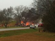 Firefighters attempt to control a house fire on U.S. Highway 40 near the Shawnee County line on Wednesday, Nov. 24, 2010.
